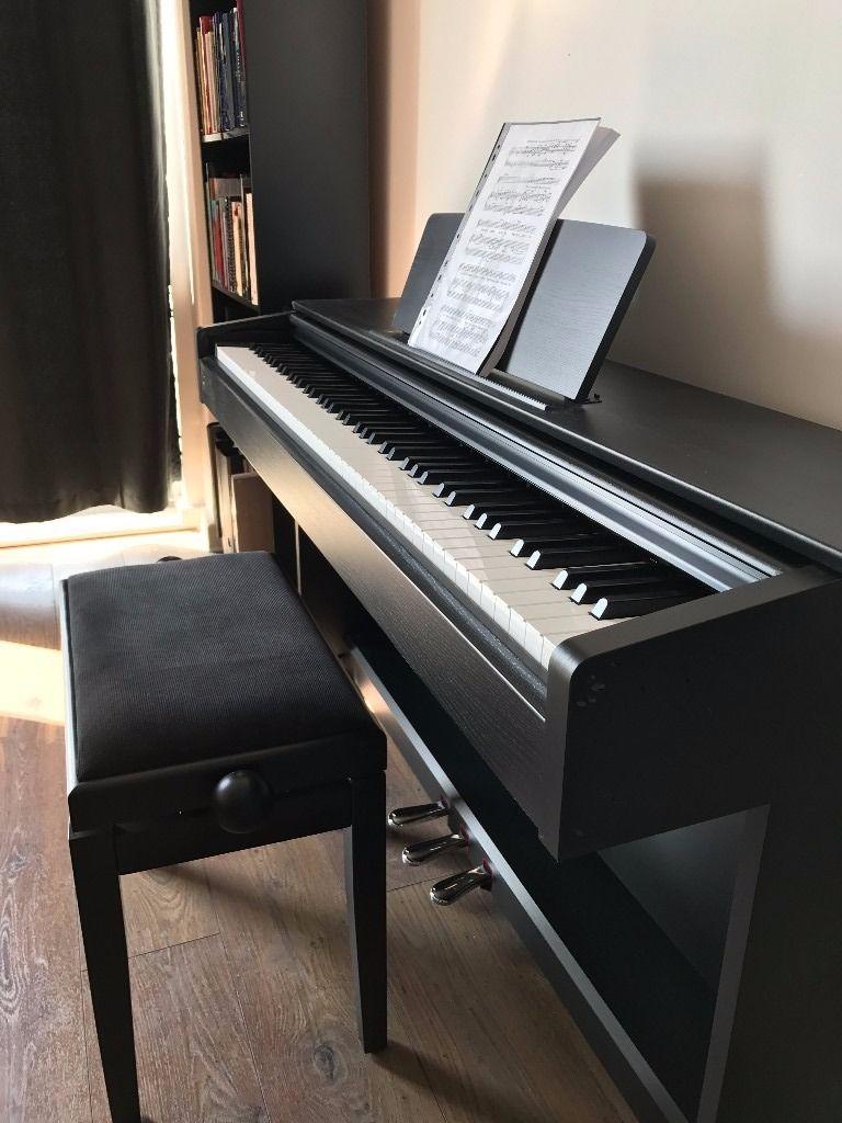 Meilleur Piano numérique pour les budgets limités : Yamaha YDP-143 Arius